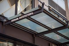 Canopy with BermanGlass Kiln Cast Glass in Corrugated texture with custom wire interlayer at Urban Outfitters - 521 Fifth Avenue, New York, New York Cast Glass, Interior Exterior, Store Fronts, Canopy, Nashville, Entrance, Urban Outfitters, It Cast, Wire