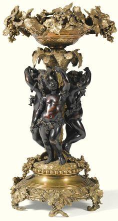 A large Napoleon III gilt-bronze and patinated-bronze centerpiece circa 1865