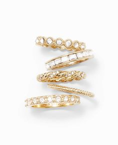 "Worn stacked or individually, this set of five shimmers with sparkly pave and gleaming goldtone for a brilliant addition to any look. 1/2"" width, stacked."