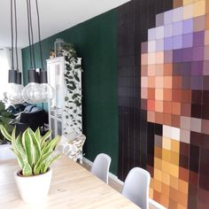 Darkgreen wall in the livingroom with an ixxi of vermeer girl with a pearl earring Copyright elskerdagmar