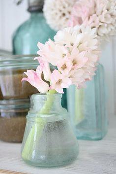 Classic aqua glass and pink flowers.