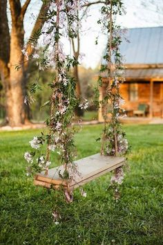 Love this flower covered swing - how whimsical.This would be a great wedding or engagement picture prop.