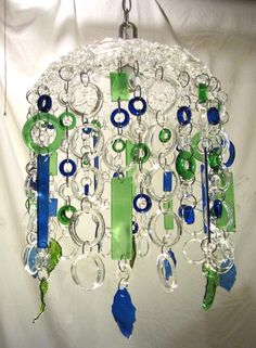 Inspiration piece for diabetes art day and all my supplies (Bottle Chandelier Repurposed) Wine Bottle Chimes, Wine Bottle Candles, Recycled Glass Bottles, Glass Wind Chimes, Wine Bottle Art, Wine Bottle Crafts, Mosaic Glass, Fused Glass, Glass Art