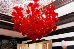 Kandi Burruss From The Real Housewives Of Atlanta Added This Hot Red Chandelier To Her New Home! #red #chandelier #homedecor #interior #interiorhomescapes  #lighting #therealhousewivesofatlanta