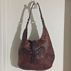 """Lucky Brand Brown Leather Patchwork Bag Lucky Brand brown leather patchwork shoulder bag. Dimensions are: 14"""" width, 9.25"""" height and 4"""" depth, 12"""" strap drop. One pocket on outside and two pockets inside. Lucky Brand Bags"""
