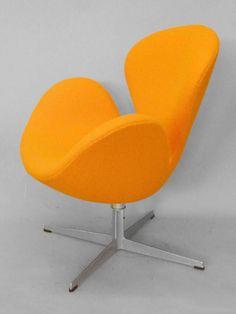 For Sale on 1stdibs - Arne Jacobsen for Fritz Hansen orange swan chair.