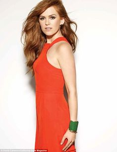 Tangerine dream: The bright orange Fendi dress didn't quite match the auburn-haired actress but still looked striking