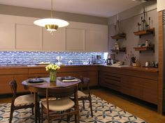 The kitchen from SATC 2... I love the 60's tiles!