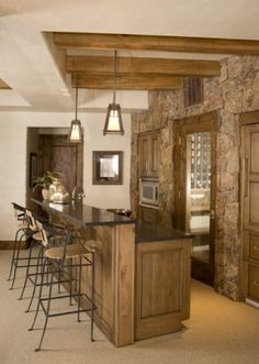 I like the stone on the wall and the beams on the ceiling. This is a basement room