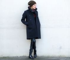 Sara Strand – black coat, jeans, boots, with plaid wool scarf!