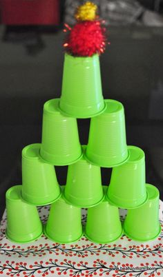 Shelley stacked the cups into a tree shape. The top cup had a star on top. The kids used bean bag snow balls to knock the cups down. Wonderful game for pre-k. Older kids would probably enjoy just as much.