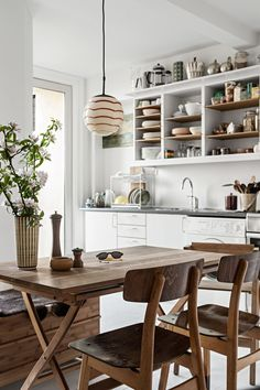 Neutral kitchen with wood accents, open shelving and mid-century details.