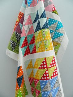 Excellent pops of color in this HST baby quilt by Svetlana Sotak of s.o.t.a.k Handmade.