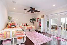 I don't like the bed spread, but I love the 2 beds for sleepovers and the huge space in the middle!