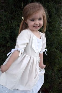 This dress does not suit our grandgirl, but I really like some of the elements that could be applied to other outfits, like the sleeve finish, the bib front and the underskirt.  The little girl in this pic is charmingly adorable in her princess dress.