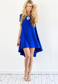 Cobalt Blue High Low Ruffle Swing BabyDoll Dress  This sophisticated swinging shift dress is the ultimate base for creating your perfect outfit, in this season's hottest colour. Sharpen up your look by teaming with a strappy shoes, or more...      Condition: New - with tags     Colour: Blue     Brand: Dolly Rocka