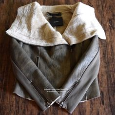 MUUBAA Jacket Draped Aviator Bomber Wrap Coat Top Women's Size Medium (US 10, EURO 42). New with tags. $998 Retail + Tax.   - Leather utility jacket with textured detailing and cream shearling lining.  - Oversized, draped collar. - Front & sleeve zip closure(s). - Intentional uneven aspect.  100% sheepskin.     • Measurements provided in comment(s) section below.   {Southern Girl Fashion - Closet Policy}   ✔️ Same-Business-Day Shipping (10am CT). ✔️ Reasonable best offer considered when…