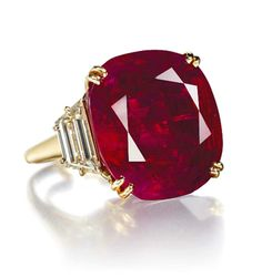 """""""The Hope Ruby,"""" a 32.08 carat Burmese ruby and diamond ring by Chaumet was the top lot sold at Lily Safra's """"Jewels for Hope"""" auction"""