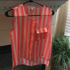 Blush and coral sleeveless blouse Previously loved. Like new. So pretty!! Buttons up. Hi low top. Polyester. Semi sheer. Hearts Tops Blouses