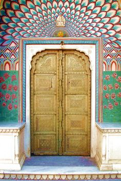Peacock Door, City Palace, Jaipur,India!  Need to find my other pics with my umbrella!