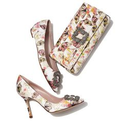 """Manolo Blahnik Gothisi Butterfly Fabric Buckle Clutch Bag, Multi Details #ONLYATNM Only Here. Only Ours. Exclusively for You. Manolo Blahnik """"Gothisi"""" clutch in butterfly-patterned satin fabric. Finished with buckle inspired by the designer's famed """"Hangisi"""" pump. Three-quarter flap top; snap closure. Inside, satin lining; zip pocket. Slim, handheld style. 4.7""""H x 9.8""""W x 1.4""""D. Bag weight: 0.4 lb. Made in Italy. Designer About Manolo Blahnik: Manolo Blahnik, the elegant master of women's…"""