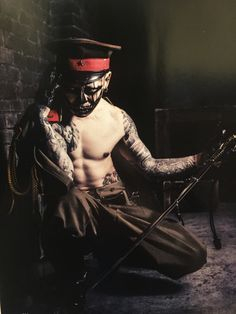 Dir en grey, Kyo tattoo tribal