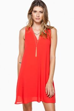 A chic and sophisticated shift dress with a V neckline.