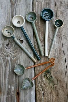 Unique handmade stoneware artisan olive spoons, made in 2 parts & joined. The bowl sections were thrown individually on the wheel. The handles: