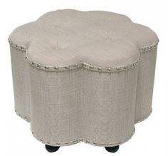 White tufted ottoman from our showroom