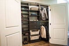 Symmetry Closets - Farmingdale, NY, United States. Highly efficient reach-in closet with shaker drawers, a wicker basket, and slide-out basket storage with canvas lining.