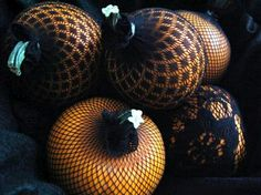 I know it's a long ways away, but this is such a clever way to glam up pumpkins.  Wrap them in lace or fishnet stockings.  <3