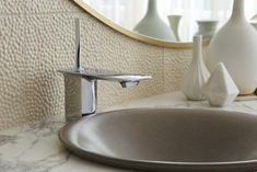 The Stance Faucet by KOHLER offers easy control over water temperature and pressure. The single-control joystick handle and refined angular spout make a unique accent for a sleek, contemporary addition to any bathoom.