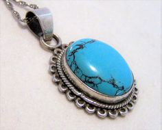 Vintage turquoise oval stone pendant with chain Stamped 925, tests for sterling silver Pendant is 1 3/8 x 7/8 inches including bale Includes an 18 inch sterling silver rope chain Very good vintage condition  International buyers welcome, I offer 13$ flat rate jewelry shipping, overcharges refunded Priority shipping is optional 102616  Want to see more great necklaces? Click here: https://www.etsy.com/your/shops/GretelsTreasures/sections/14162759  C...