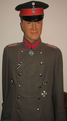Imperial German officer's WWI uniform tunic and cap.  Decorations include the Pour le Merite and Iron Cross.