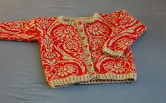 Stunning sweater with norwegian motif. I need to work out this colorwork chart. floral and elaborate, but somehow not tipping me over to too fussy. maybe it's the red and cream rather than the pattern? Knitting For Kids, Knitting Projects, Baby Knitting, Sweater Knitting Patterns, Knitting Charts, Cardigan Pattern, Norwegian Knitting, Toddler Sweater, Fair Isle Knitting