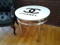 CHANEL Modern round side table, lamp table. white with black logo.