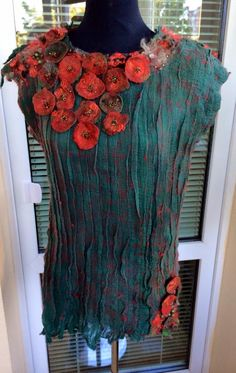 Emerald green wool felt tunic with 3D felted poppies by Nadin Smo design.