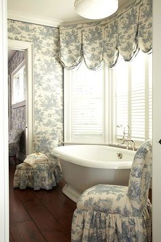 bathroom in toile from Traditional Home, off the bedroom, also done completely in blue and white toile