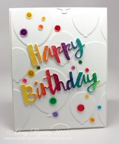 White on white die cut balloons for background topped off with a die cut colored with distress inks
