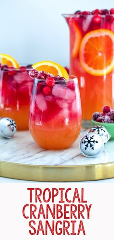 Tropical Cranberry Sangria Your favorite summer drink just transitioned to winter! This Tropical Cranberry Sangria is made with Mija Sangria, orange juice, and fresh cranberry juice. It will have you serving winter sangria all holiday season long. Winter Sangria, Cranberry Sangria, Drinks With Cranberry Juice, Cranberry Recipes, Winter Drinks, Holiday Drinks, Party Drinks, Fun Drinks, Yummy Drinks
