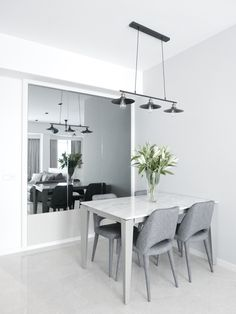 Dining area by D'Marvel Scale Dining Area, Dining Table, Interior Design Companies, White Tiles, Floors, Tile Floor, Architecture, Kitchen, Arquitetura