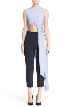 Intriguing concept (needs mod): asymmetric concrete sleeveless crêpe bodice, navy wasted fitted trousers