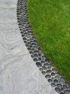 Edging - just stick polished rocks in concrete. This looks nice and clean