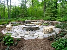 Fire pit with flagstone surround.