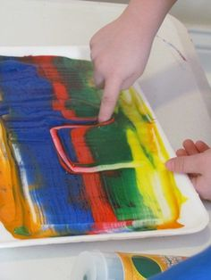 Practice writing in paint on styrofoam trays
