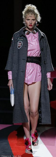 Stylish:Joining the catwalk crew was Lara Stone who looked worlds away from her arrival look as she was super glam in a pink gingham playsuit with Eighties-inspired curls