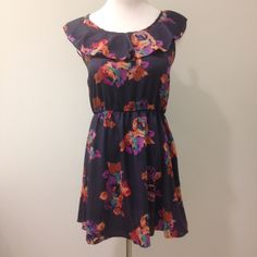 Beautiful dress with sexy cut out in back. Ruffled neck and elastic waist. 100% polyester. Shown on size Medium. Runs a bit small. Dresses