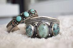 Silver/turquoise bracelets.