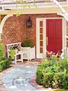 Nothing is more appealing than a cheery red front door! More curb appeal ideas: http://www.bhg.com/home-improvement/exteriors/curb-appeal/curb-appeal-on-a-dime/?socsrc=bhgpin022214addedging&page=13