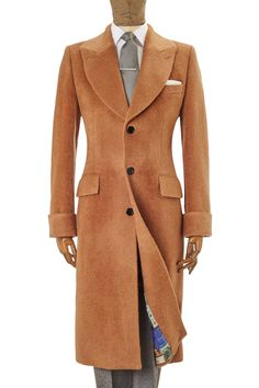 <p><p>This supremely stylish coat is crafted in baby llama and pure new wool from one of Italy's finest mills.<p><p>The styling is classic 1940s elegant menswear with curved revers, two flap pockets and gauntlet cuffs. The weight and pile of the fabric make it warm yet relatively lightweight, giving the wearer superior warmth and comfort in the harshest of British Winters.<p><p>The coat is finished with black gloss horn buttons and lined in our exclusive 150th anniversary design.<p><p>